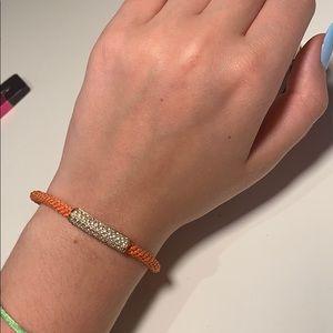 Orange Michael kors bracelet